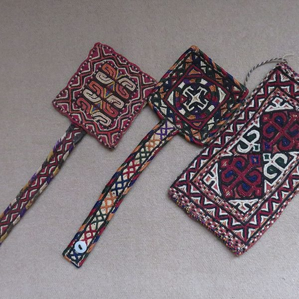 Turkmenistan - Yomud tribal arm bands and a finely embroidered bag