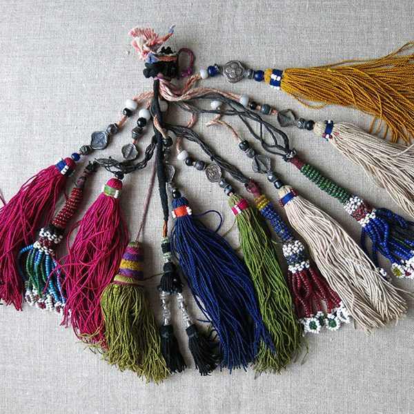 Afghanistan - group of various size and origin tribal tassels