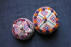 TURKMENISTAN Probably Tekke tribe - two similar silk embroidered ethnic child hats