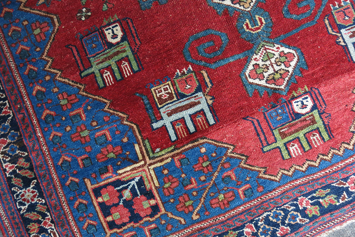 Where did the tradition go to hang the carpet on the wall
