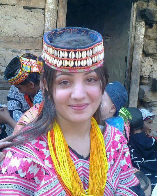 Kalash girl wearing traditional head gear